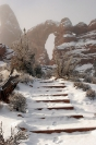 Snowy Steps to Arch in Arches National Monument, Utah